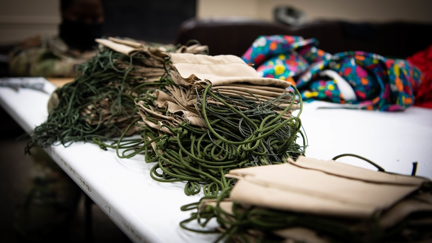 Completed face masks sewn by 2nd Operations Support Squadron Airmen are placed on a table at Barksdale Air Force Base, La., April 16, 2020. Mask making material has been donated by Barksdale residents and community partners. (U.S. Air Force photo by Airman 1st Class Jacob B. Wrightsman)