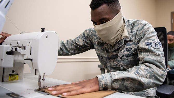 Airman 1st Class David S. Kyambadde, 2nd Operations Support Squadron aircrew flight equipment maintainer, operates a sewing machine to sew face masks at Barksdale Air Force Base, La., April 16, 2020. All Airmen of the 2nd OSS AFE shop learned to sew as part of their technical training to repair aircrew equipment including parachutes, flight suits and other various equipment. (U.S. Air Force photo by Airman 1st Class Jacob B. Wrightsman)