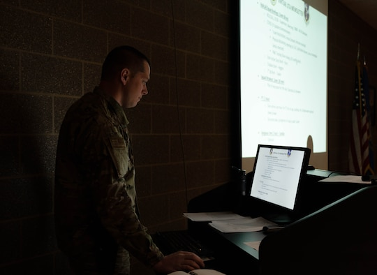 Tech. Sgt. Jared Mengenhausen, 114th Security Forces training manager, looks over the training material for the Security Forces Squadron's first virtual unit training assembly.
