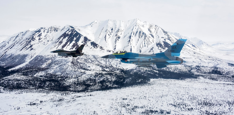 Two U.S. Air Force F-16 Fighting Falcons assigned to the 18th Aggressor Squadron fly over the Joint Pacific Alaska Range Complex, April 17, 2020.