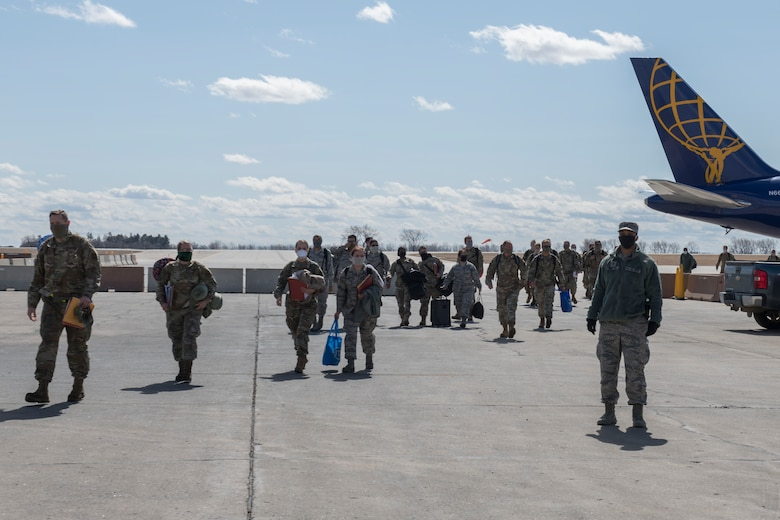Airmen walking away from Airplane