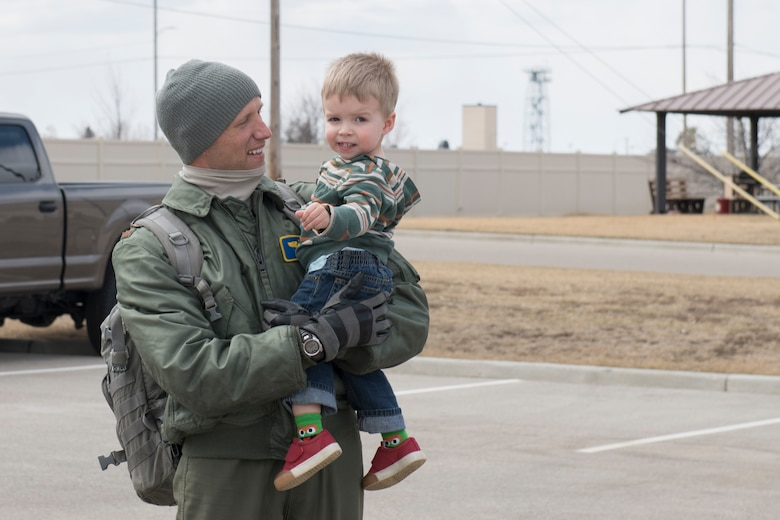 A pilot hold his son
