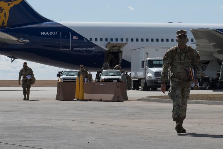 An Airmen walks away from plane