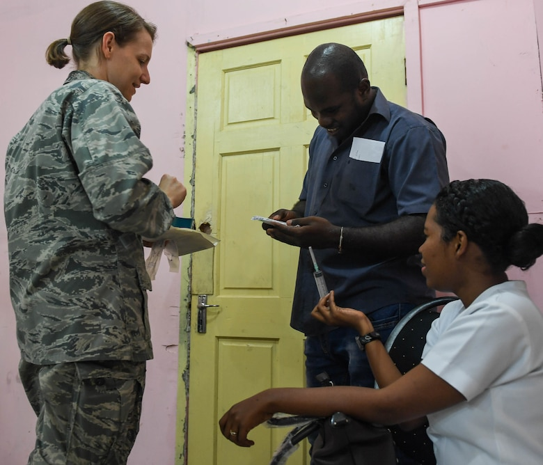 U.S. Air Force Capt. Rebecca Lauters, general medicine doctor assigned to 96th Medical Group at Eglin Air Force Base, teaches Guyanese medical personnel how to administer a shot at the Linden Mackenzie Hospital during New Horizons exercise 2019 in Linden, Guyana, June 13, 2019. The New Horizons exercise 2019 provides U.S. military members an opportunity to train for an overseas deployment and the logistical requirements it entails. The exercise promotes bilateral cooperation by providing opportunities for U.S. and partner nation military engineers, medical personnel and support staff to work and train side by side. (U.S. Air Force photo by Senior Airman Derek Seifert)