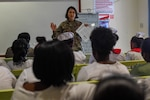 U.S. Air Force Maj. Melissa Legowski, nurse practitioner from the 99th Medical Group at Nellis Air Force Base, briefs Guyanese nurses during a lecture at the Linden Mackenzie Hospital during New Horizons exercise 2019 in Linden, Guyana, June 13, 2019.  The New Horizons exercise 2019 provides U.S. military members an opportunity to train for an overseas deployment and the logistical requirements it entails. The exercise promotes bilateral cooperation by providing opportunities for U.S. and partner nation military engineers, medical personnel and support staff to work and train side by side. (U.S. Air Force photo by Senior Airman Derek Seifert)