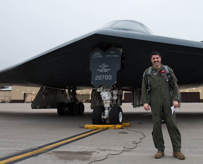 U.S. Air Force Lt. Col. James Ashlock, 131st Bomb Wing director of plans and programs, stands in front of a B-2 Spirit stealth bomber at Whiteman Air Force Base, Missouri, March 18, 2020. Throughout Ashlock's career, he has completed 208 sorties,  during his final flight before retiring he reached the milestone of flying 1000 hours in a B-2. (U.S. Air Force photo by Airman 1st Class Christina Carter)