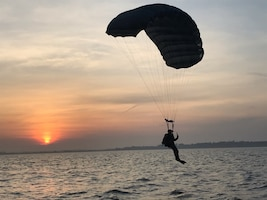 One person parachuting into the sea.