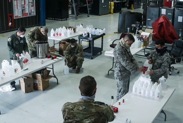Dyess Airmen create hand sanitizer.