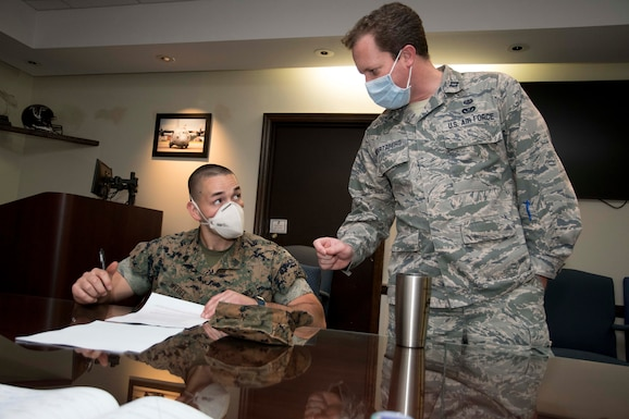 Capt. Greg Swartzberg, 94th Airlift Wing deputy staff judge advocate, helps a Marine fill out a legal form worksheet in the wing conference room at Dobbins Air Reserve Base, Ga. on April 9, 2020.