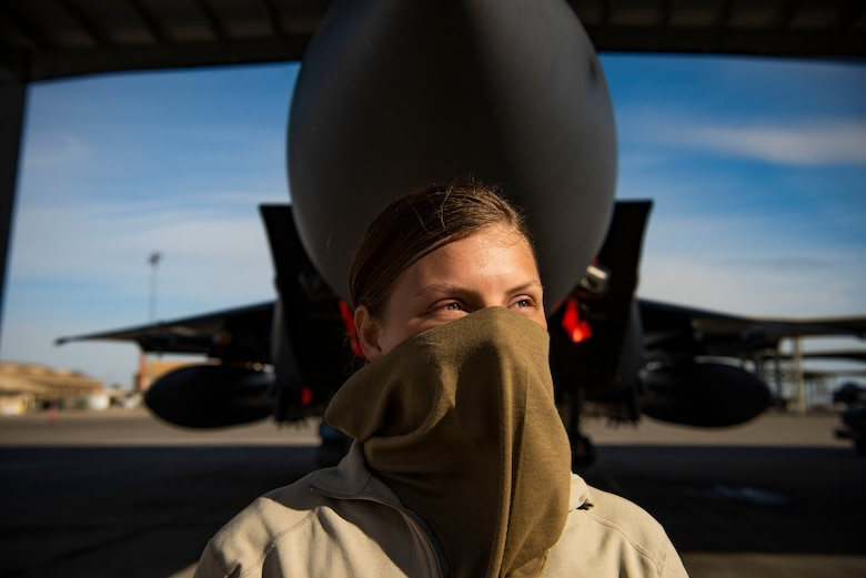 U.S. Air Force Airman 1st Class Kristin Lyons, 391st Fighter Squadron crew chief, wears a cloth mask while working during the COVID-19 pandemic, April 14, 2020, at Mountain Home Air Force Base, Idaho. 391st FS Airmen are working in two teams with a week-on and week-off schedule to avoid the potential spread of COVID-19. (U.S. Air Force photo by Airman 1st Class Andrew Kobialka)