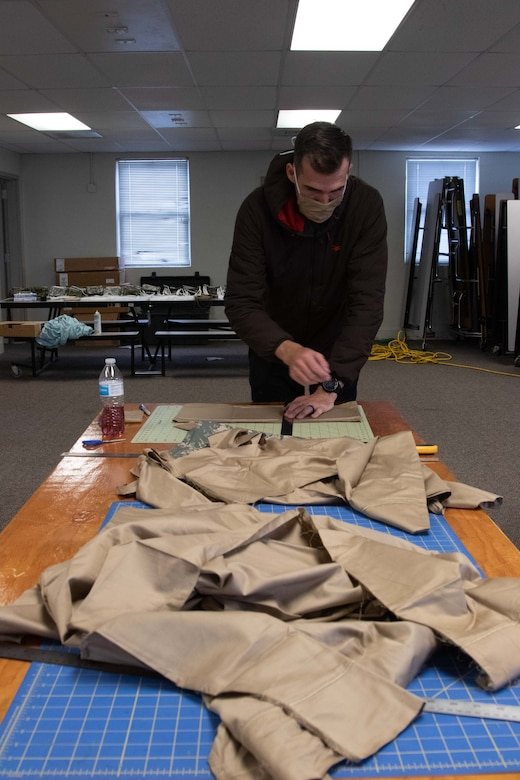To slow the spread of COVID-19 among Soldiers and Airmen in the Utah National Guard, parachute riggers with 19th Special Forces Group (Airborne), at Camp Williams, use their skills to make approximately 2,000 face masks.