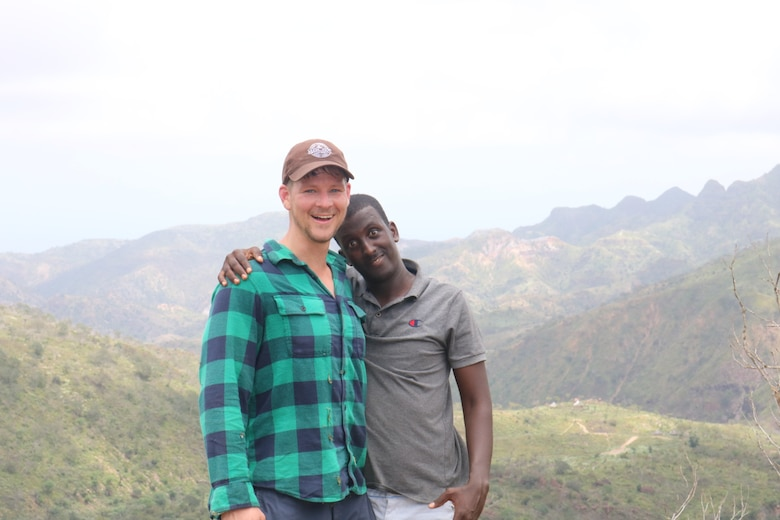 1st Lt. Will Boss, Air Force wildlife ecologist, takes a photo with his guide Mohammad while participating in a wildlife assessment in the Horn of Africa nation of Djibouti in March 2020.