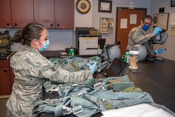 Airmen sewing masks
