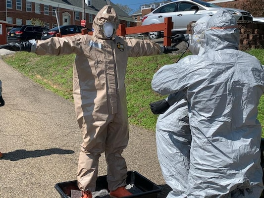 A member of the West Virginia National Guard Task Force CRE undergoes decontamination following COVID-19 testing at a veterans home facility April 20, 2020. The West Virginia National Guard conducted COVID-19 testing at two veterans home facilities in Barboursville and Clarksburg totaling 411 patients and staff following an executive order issued by Governor Jim Justice to test all nursing home facilities in the state. (West Virginia National Guard photo)