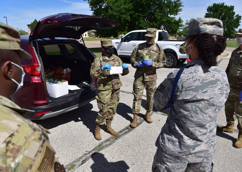 U.S. Air Force Tech. Sgt. Britteny Griffith, 17th Training Wing command chief executive assistant, briefs volunteers before delivering care packages to 17th TRW members in isolation on Goodfellow Air Force Base, Texas, April 20, 2020. Griffith is spearheading the base portion of the initiative, which is a joint project between the base and local civic leaders to ensure inbound members are taken care of during their mandatory isolation period as a result of the COVID-19 pandemic. (U.S. Air Force photo by Staff Sgt. Chad Warren)
