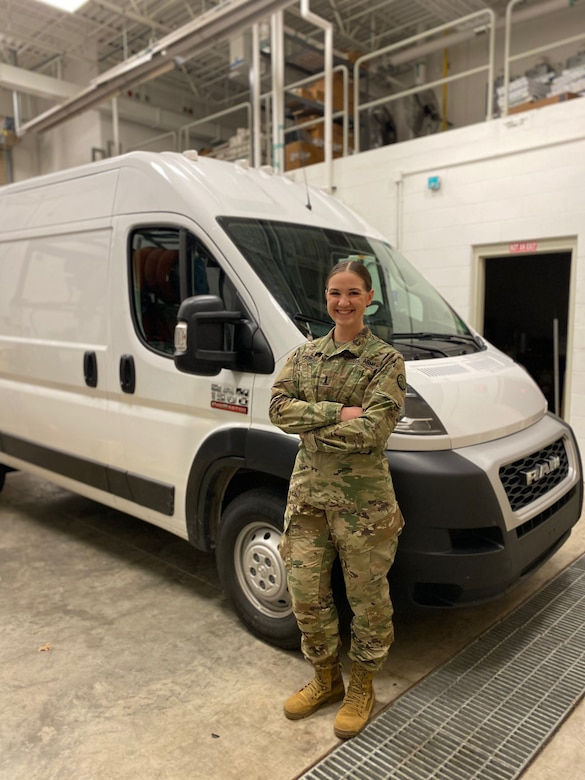 West Virginia Army National Guard 1st Lt. Samantha Fabian, commander of the 1201st Forward Support Company, poses in front of a mobile testing lab April 21, 2020. Fabian, the program director who leads the mobile laboratories, has been an instrumental part of establishing the DoD's first mobile testing labs for the National Guard. (courtesy photo)