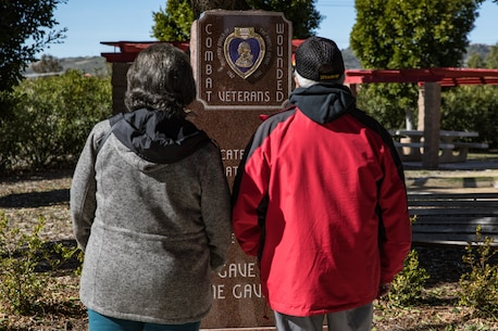 Retired U.S. Marine Corps Gunnery Sgt. Carlos Mariscal and his wife, both members of the 1st Marine Division Association, visit 5th Marine Regiment's Memorial Garden on Marine Corps Base Camp Pendleton, California, Jan. 30, 2020. The veterans visited the memorial to honor those Marines and Sailors who gave the ultimate sacrifice while serving with 1st Marine Division. (U.S. Marine Corps photo by Cpl. Alexa M. Hernandez)