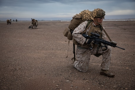 U.S. Marine Corps Cpl. Jonah Massey, an infantry assault Marine with 2nd Battalion, 5th Marine Regiment, 1st Marine Division, patrols during exercise Steel Knight 20 (SK20) at Naval Air Facility El Centro, California, Dec. 7, 2019. SK20 increases the ability of all participants to plan, communicate and conduct operations against a capable near-peer adversary with a focus on major combat maneuvers and sustainment. (U.S. Marine Corps photo by Sgt. Alina Thackray)
