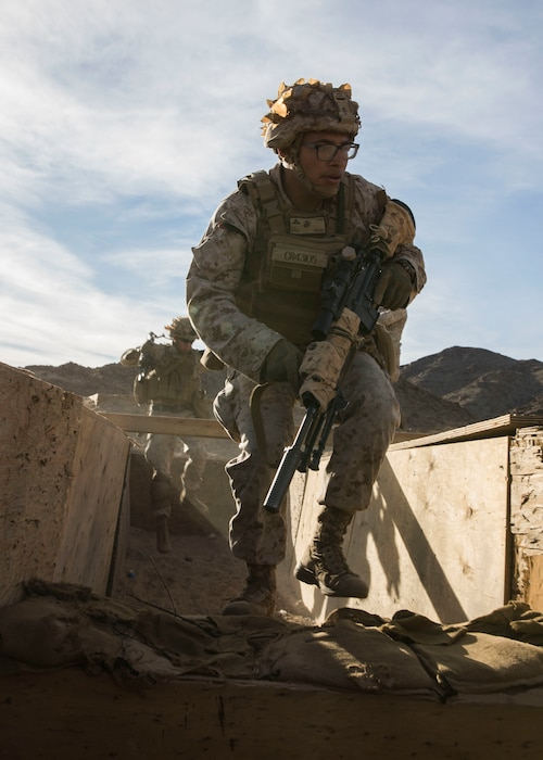 U.S. Marines with 1st Battalion, 3rd Marine Regiment, 3rd Marine Division enter and clear a bunker during the Integrated Training Exercise (ITX) at Marine Air Ground Combat Center Twentynine Palms, California, Jan. 25, 2020. ITX is a month-long training event that applies combined-arms maneuver and offensive and defensive operations to prepare Marines for deployment. (U.S. Marine Corps photo by Cpl. Jack C. Howell)