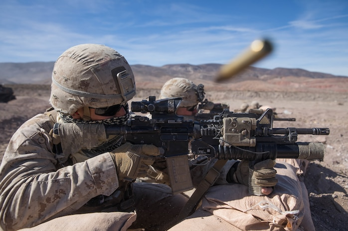 U.S. Marine Corps Lance Cpl. Darrion Green a Rifleman with 1st Battalion, 3rd Marine Regiment, 3rd Marine Division holds the defense during the Intergraded Training Exercise (ITX) at Marine Air Ground Combat Center Twentynine Palms. Jan. 25, 2020. ITX is a month long training event that prepares Marines for deployment and contains multiple ranges that applies combined-arms maneuver and offensive and defensive operations during combat. (U.S. Marine Corps photo by Cpl. Jack C. Howell)
