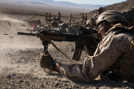 U.S. Marine Corps Lance Cpl. Darrion Green, a rifleman with 2nd Battalion, 5th Marine Regiment, 1st Marine Division, holds the defense during the Integrated Training Exercise (ITX) at Marine Air Ground Combat Center Twentynine Palms, California, Jan. 25, 2020. ITX is a month-long training event that applies combined-arms maneuver and offensive and defensive operations to prepare Marines for deployment. (U.S. Marine Corps photo by Cpl. Jack C. Howell)