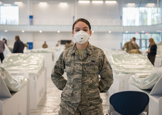 Airman 1st Class Arielle Robles, 103rd Maintenance Group administration specialist, helps set up recovery center beds at Kaiser Hall at Central Connecticut State University in New Britain, Connecticut, April 21, 2020. Robles is an exercise science student at the university and is now helping convert her usual classroom building into surge capacity space for local hospitals in response to the COVID-19 pandemic. (U.S. Air National Guard photo by Staff Sgt. Steven Tucker)