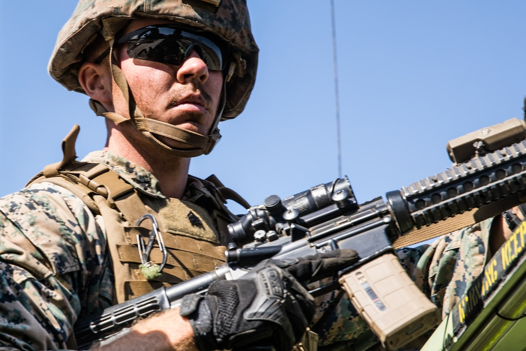 U.S. Marine Corps Sgt. Matthew Traver, a rifleman with 1st Battalion, 5th Marine Regiment, 1st Marine Division, posts security during the Marine Corps Combat Readiness Evaluation (MCCRE) on Marine Corps Base Camp Pendleton, California, Sept. 18, 2019. 5th Marines conducted a regimental-sized MCCRE that included 1st Battalion, 5th Marines, 2nd Battalion, 5th Marines, and the Regimental Headquarters to increase the combat proficiency and readiness of the regiment. The MCCRE took place over a 10-day period and served as a proof of concept for future regimental-sized MCCREs. (U.S. Marine Corps photo by Lance Cpl. Alexa M. Hernandez)