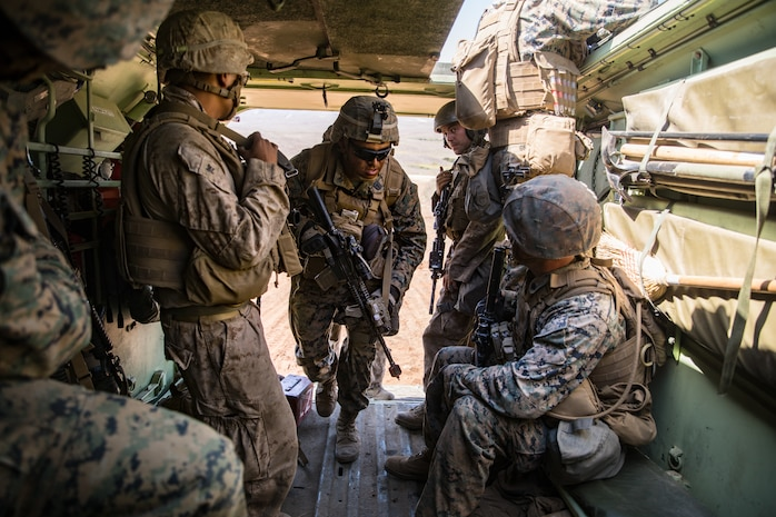 U.S. Navy HM2 Andrew Franco, center, a corpsman with 1st Battalion, 5th Marine Regiment, 1st Marine Division, enters an Amphibious Assault Vehicle during the Marine Corps Combat Readiness Evaluation (MCCRE) on Marine Corps Base Camp Pendleton, California, Sept. 18, 2019. 5th Marines conducted a regimental-sized MCCRE that included 1st Battalion, 5th Marines, 2nd Battalion, 5th Marines, and the Regimental Headquarters to increase the combat proficiency and readiness of the regiment. The MCCRE took place over a 10-day period and served as a proof of concept for future regimental-sized MCCREs. (U.S. Marine Corps photo by Lance Cpl. Alexa M. Hernandez)