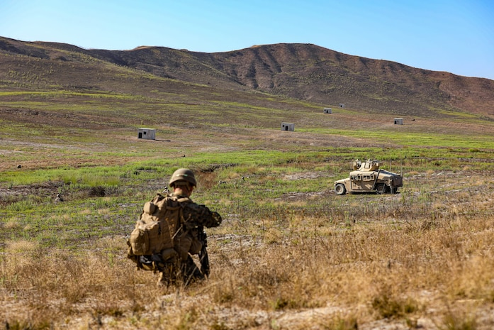 A U.S. Marine with 2nd Battalion, 5th Marine Regiment, 1st Marine Division, patrols during a Marine Corps Combat Readiness Evaluation (MCCRE) on Marine Corps Base Camp Pendleton, California, Sept. 18, 2019. 5th Marines conducted a regimental-sized MCCRE for 1st Battalion, 5th Marines and 2nd Battalion, 5th Marines, as well as the Regimental Headquarters to increase the combat proficiency and readiness of the regiment. The MCCRE took place over a 10 day period and served as proof of concept for future regimental-sized MCCREs. (U.S. Marine Corps photo by Lance Cpl. Roxanna Ortiz)