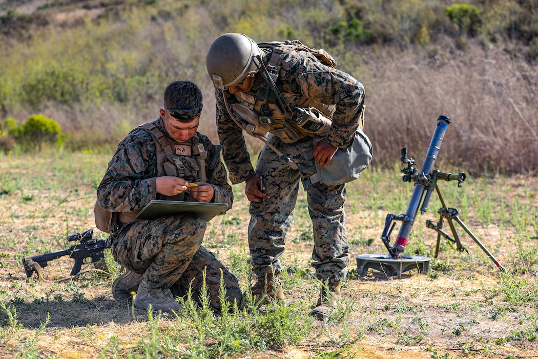 U.S. Marine Corps Cpl. Edgar Barajachavez, right, a squad leader instructs Pfc. Brock Barton, a mortarman, both with 2nd Battalion, 5th Marine Regiment, 1st Marine Division, during a Marine Corps Combat Readiness Evaluation (MCCRE) on Marine Corps Base Camp Pendleton, California, Sept. 22, 2019. 5th Marines conducted a regimental-sized MCCRE for 1st Battalion, 5th Marines and 2nd Battalion, 5th Marines, as well as the Regimental Headquarters to increase the combat proficiency and readiness of the regiment. The MCCRE took place over a 10 day period and served as proof of concept for future regimental-sized MCCREs. (U.S. Marine Corps photo by Lance Cpl. Roxanna Ortiz)