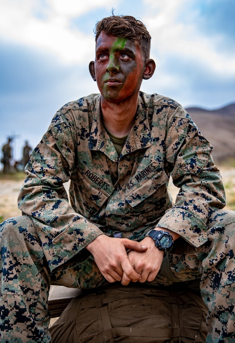 U.S. Marine Corps Cpl. James Roberts, a combat engineer with 1st Combat Engineer Battalion, 1st Marine Division, rests on his pack during a Marine Corps Combat Readiness Evaluation (MCCRE) on Marine Corps Base Camp Pendleton, California, Sept. 23, 2019. 5th Marines conducted a regimental-sized MCCRE for 1st Battalion, 5th Marines and 2nd Battalion, 5th Marines, as well as the Regimental Headquarters to increase the combat proficiency and readiness of the regiment. The MCCRE took place over a 10 day period and served as proof of concept for future regimental-sized MCCREs. (U.S. Marine Corps photo by Lance Cpl. Roxanna Ortiz)