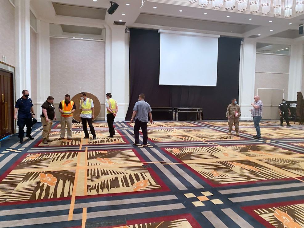 Representatives from the U.S. Army Corps of Engineers (USACE), Honolulu District, the government of Guam, the Federal Emergency Management Agency (FEMA), NAVFAC Marianas, U.S. Department Health and Human Services, and 18th MEDCOM evaluate the ballroom inside the Sheraton Laguna Guam Resort Spa  in Tamuning for potential use as an Alternate Care Facility.