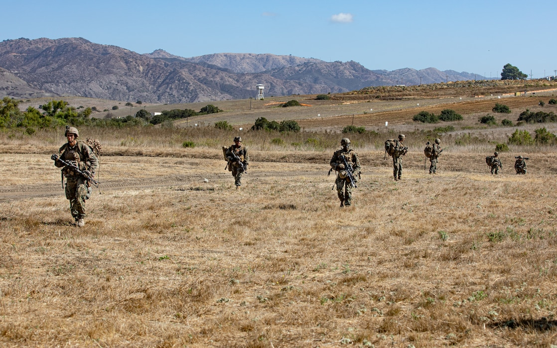 U.S. Marines with 2nd Battalion, 5th Marine Regiment, 1st Marine Division, patrol during a Marine Corps Combat Readiness Evaluation (MCCRE) on Marine Corps Base Camp Pendleton, California, Sept. 23, 2019. 5th Marines conducted a regimental-sized MCCRE for 1st Battalion, 5th Marines and 2nd Battalion, 5th Marines, as well as the Regimental Headquarters to increase the combat proficiency and readiness of the regiment. The MCCRE took place over a 10 day period and served as proof of concept for future regimental-sized MCCREs. (U.S. Marine Corps photo by Lance Cpl. Roxanna Ortiz)