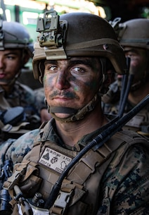 U.S. Marine Corps Cpl. Daniel Stolp, a squad leader with 2nd Battalion, 5th Marine Regiment, 1st Marine Division, rides in an assault amphibious vehicle during a Marine Corps Combat Readiness Evaluation (MCCRE) on Marine Corps Base Camp Pendleton, California, Sept. 23, 2019. 5th Marines conducted a regimental-sized MCCRE for 1st Battalion, 5th Marines and 2nd Battalion, 5th Marines, as well as the Regimental Headquarters to increase the combat proficiency and readiness of the regiment. The MCCRE took place over a 10 day period and served as proof of concept for future regimental-sized MCCREs. (U.S. Marine Corps photo by Lance Cpl. Roxanna Ortiz)