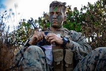 U.S. Marine Corps Cpl. Marshall Porritt, a platoon sergeant, with 2nd Battalion, 5th Marine Regiment, 1st Marine Division, finishes applying face paint during a Marine Corps Combat Readiness Evaluation (MCCRE) on Marine Corps Base Camp Pendleton, California, Sept. 24, 2019. 5th Marines conducted a regimental-sized MCCRE for 1st Battalion, 5th Marines and 2nd Battalion, 5th Marines, as well as the Regimental Headquarters to increase the combat proficiency and readiness of the regiment. The MCCRE took place over a 10 day period and served as proof of concept for future regimental-sized MCCREs. (U.S. Marine Corps photo by Lance Cpl. Roxanna Ortiz)