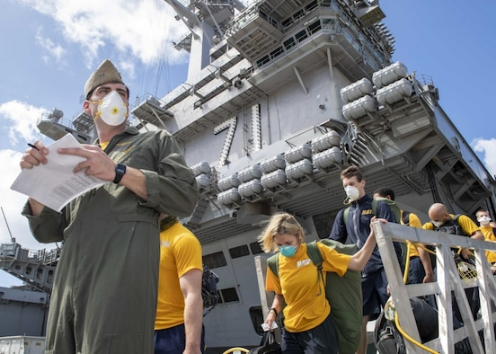 U.S. Sailors assigned to the aircraft carrier USS Theodore Roosevelt (CVN 71) depart the ship to move to off-ship berthing April 10, 2020. Upon arriving in Guam March 27, Theodore Roosevelt established an Emergency Command Center, initiated a roving and deep cleaning team, and continually educated the crew on social distancing and proper protective procedures and behaviors, to assist the crew in mitigating and controlling the spread of COVID. Theodore Roosevelt is in Guam for a scheduled port visit for resupply and crew rest during their scheduled deployment to the Indo-Pacific.