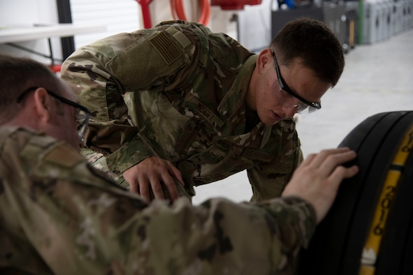 A1C Benjamin Missel inspects a landing gear trainer in the F-35 Academic Training Center, Eglin Air Force Base, Fla. on Mar. 12, 2020.