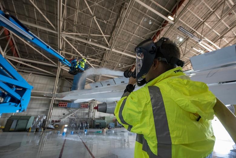 An airman cleans an E-4B at Offutt Air Force Base