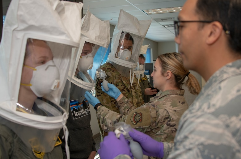 60th Aerospace Medicine Squadron Bioenvironmental Engineering Flight technicians perform N95 mask fit tests on aircrew at Travis Air Force Base, California, April 10, 2020. The bioenvironmental engineering flights conduct respirator and gas mask fit tests to protect Airmen and maintain a healthy workforce. They also perform environmental, occupational and radiological surveillance. (U.S. Air Force photo by Heide Couch)