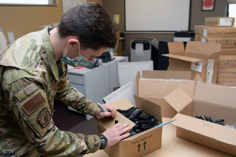 Airman writes on box.