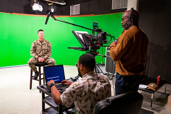 Code 1170 Videographers Greg Boyd and Alim Jordan set up the teleprompter to film NNSY Commander Capt. Kai Torkelson as he shares the latest COVID-19 update with the workforce.
