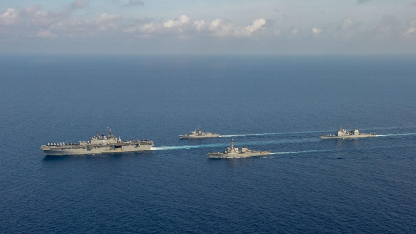 U.S. Navy Amphibious assault ship USS America (LHA 6), left, sails with Royal Australian Navy guided-missile frigate HMAS Parramatta (FFH 154), Arleigh-Burke class guided missile destroyer USS Barry (DDG 52) and Ticonderoga-class guided-missile cruiser USS Bunker Hill (CG 52). Bunker Hill is deployed to the U.S. 7th Fleet area of operations and is operating with the America Expeditionary Strike Group in support of security and stability in the Indo-Pacific region.