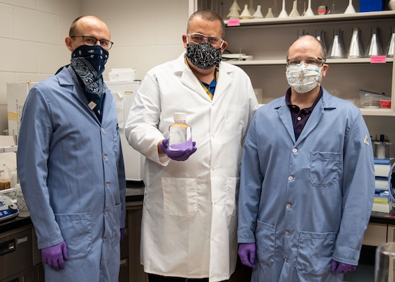 The Biotechnology Research and Development Laboratory team at Naval Surface Warfare Center Panama City Division is rapidly delivering hand sanitizer solutions to help personnel stop the spread of the COVID-19 virus.  Pictured from left to right: Dr. Travis Hand, Dr. Josh Kogot and Jeff Eichler.