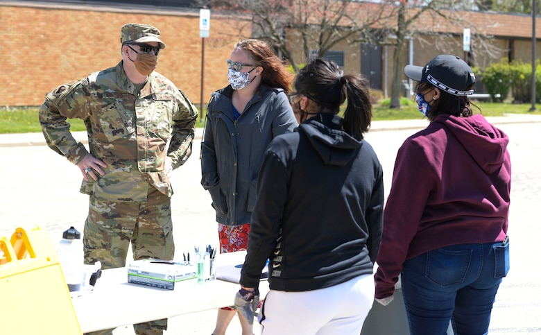 U.S. Air Force Col. Michael Phillips, 88th Air Base Wing vice commander, talks with volunteers manning a donation drop off point outside the chapel located in the Prairies housing area at Wright-Patterson Air Force Base, Ohio, April 21, 2020. (U.S. Air Force photo/Wesley Farnsworth)