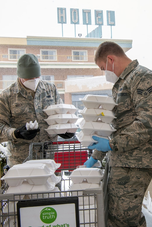Colorado Air National Guard aircraft structural maintenance mechanic, deliver meals to guests at a hotel in Denver