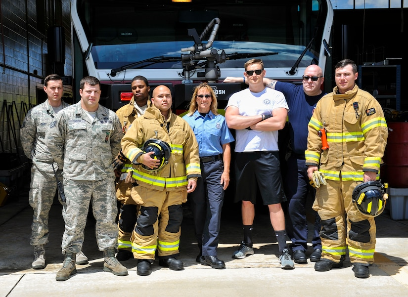 Members of the 628th Civil Engineer Squadron fire department pose for a picture at North Auxiliary Airfield in North, S.C., April 17, 2020. Roughly 90 miles away from the Air Base side of Joint Base Charleston is a 3,500-foot runway known as the assault landing zone at North Auxiliary Airfield in North, South Carolina. Team Charleston's 628th Civil Engineer Squadron operates the base. The base directly supports the 437th and 315th Airlift Wing's C-17 Globemaster III aircrew training and proficiency training. The only permanently assigned personnel at North Auxiliary Airfield are rotational firefighters and a civilian grounds keeper. The firefighters provide 24-hour emergency services to the base as well as the surrounding communities.