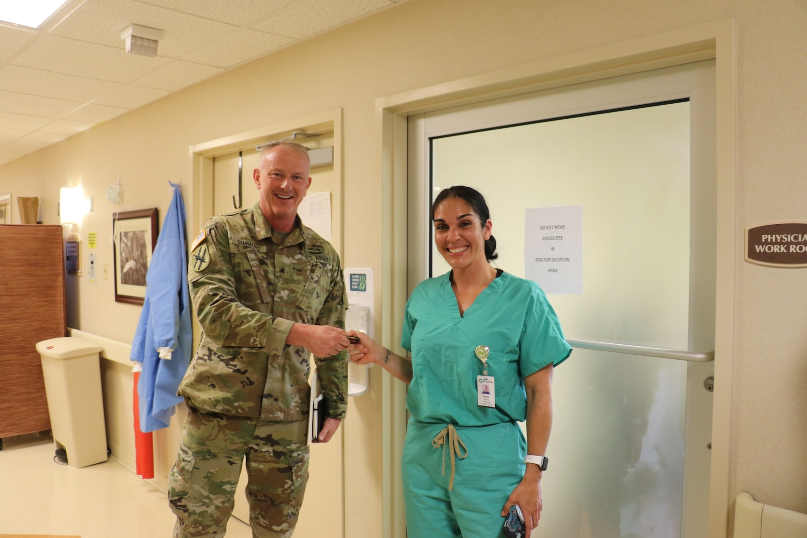 Gen. Randall Simmons, commander, Georgia Army National Guard, recognized Spc. Leslie Davila, a medic with the 2nd Battalion, 121st Infantry Regiment, 48th Infantry Brigade Combat Team, for her contributions to the fight against COVID-19 during a tour of the Phoebe Putney Memorial Hospital in Albany, Georgia, March 28, 2020. Davila and her son, also with the Guard, were both assigned as medics at the hospital.