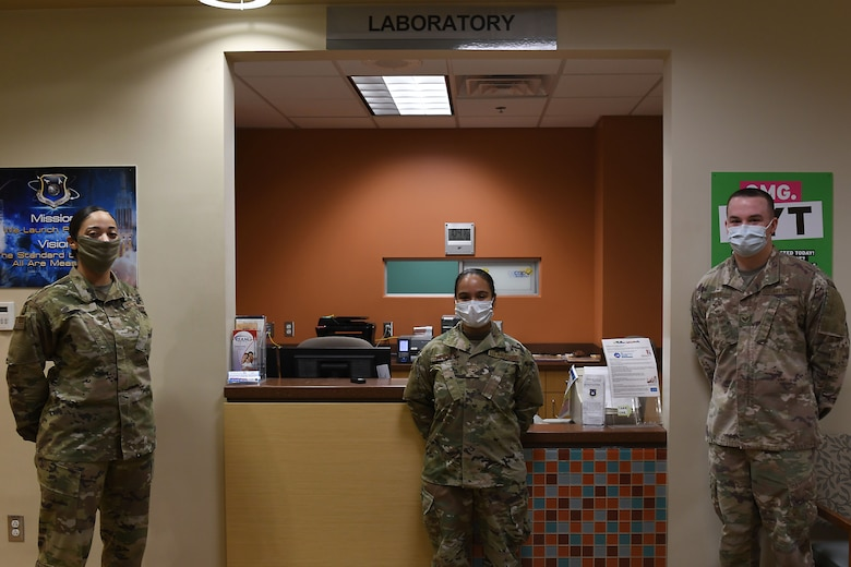 Members assigned to the 30th Healthcare Operations Squadron Laboratory pose for a photo in celebration of Medical Laboratory Professionals Week, also known as Lab Week, April 20, 2020, at Vandenberg Air Force Base, Calif.