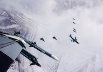 A seven-ship formation of U.S. Air Force F-35A Lightning II,  F-22 Raptor fifth-generation fighters, and F-16C Fighting Falcon fighter aircraft, as well as a KC-135R Stratotanker flies over the Joint Pacific Alaska Range Complex April 21, 2020.