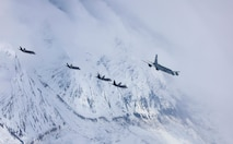 A five-ship formation of U.S. Air Force F-35A Lightning II and F-22 Raptor fifth-generation fighters and a KC-135R Stratotanker flies over the Joint Pacific Alaska Range Complex April 21, 2020.